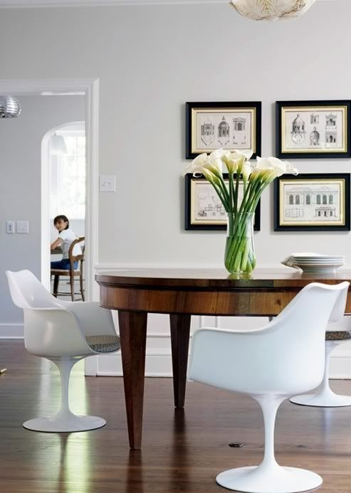 pairing modern chairs with vintage tables.